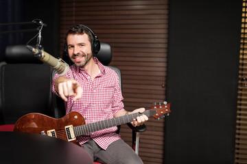 Popular male latin musician at radio show