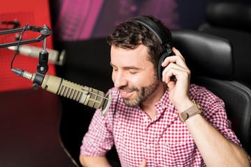 Smiling male radio presenter