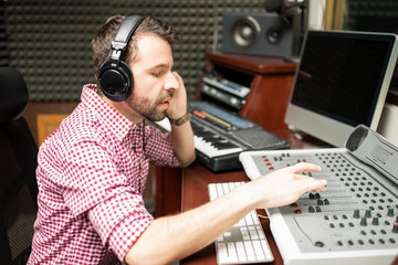 Sound engineer working on mixing console