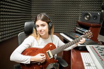 Female music artist composing music