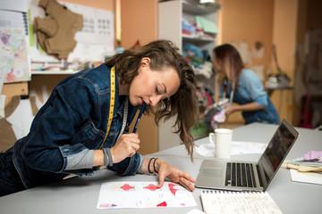 Designer clothes and dressmaker, working in the workshop