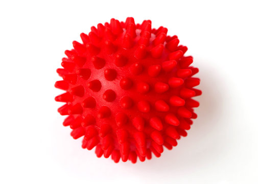 Red colorful bright isolated spiky ball toy, macro