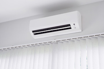 Air conditioner on white wall background