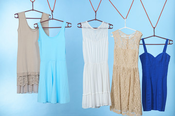 Colorful dresses hanging on clothes hanger