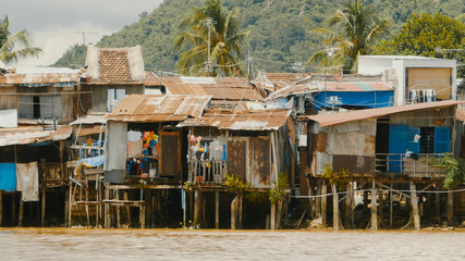 Slums in Nha Trang. Houses on the river.