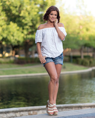 Lovely Woman in a Off Shoulder Top and Denim Shorts - Full Length