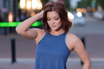 Cute Woman in a Blue Tank Top - Urban Scene