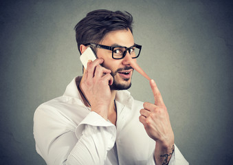 Man speaking on phone and lying