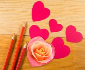pencils and decorative hearts