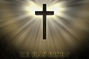 Jesus Christ cross elevated, raised up, shrouded by light and glow and He has risen text written on a stone background. Christian, religious Easter card. resurrection, belief, new life, hope concept