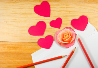 image of envelope, rose flower, pencils and stylized hearts