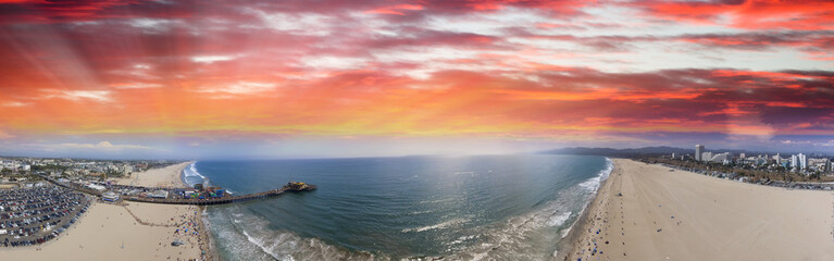Aerial panoramic view of Santa Monica coastline and pier at dusk, CA Wall mural