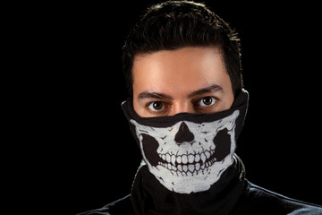 The man in the mask with skull.
