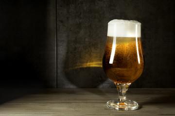 ale beer  in twilight on wood