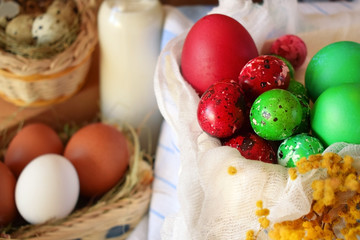 Red and green coloured eggs. Preparation for Easter celebration