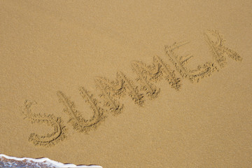 The word with hashtag Summer in the sand against the sea