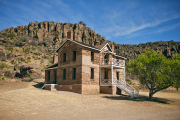 Historic old houses in a desert landscape.