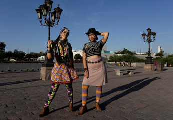 """Sisters Carmen and Gala Lazo Freyman pose for a picture wearing clothes of their creation called """"Mamarracho style"""" (Mess style) in Monterrey"""