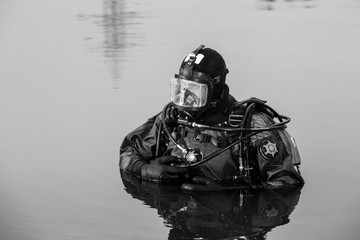 brave diver rescuer comes out of the water