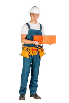 male builder or manual worker in helmet over white wall background. repair, construction, building, people and maintenance concept