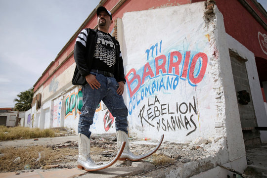 TV host Farid Pina poses for a picture wearing his Mexican Pointy Boots in Ciudad Juarez