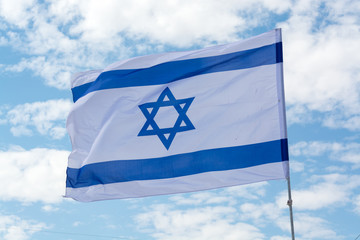 Flag of State of Israel and blue sky, white-blue with Star of David, Magen David, celebration of 70 years of israel, symbol of the state