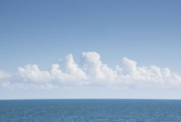 White cumulus clouds above blue Atlantic Ocean Fotoväggar