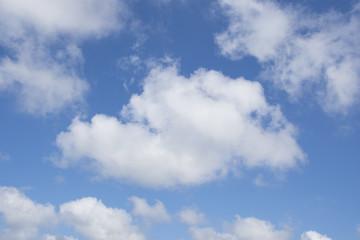 Beautiful puffy cumulus white clouds against blue sky
