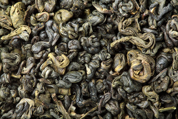 Green tea texture.Closeup.Macro shot.Pile of dry green tea.
