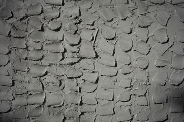 Textured grey cement wall