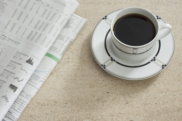 Newspaper and coffee on table