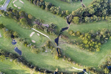 Aerial view of a golf course and landscape