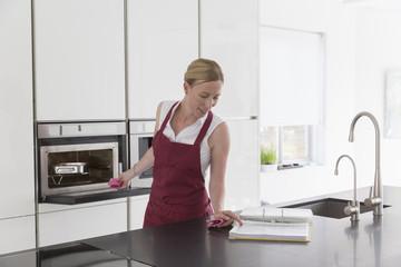 Mature woman preparing food in modern kitchen