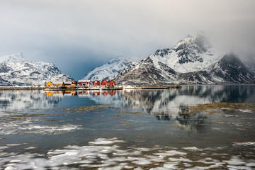 Poster Reflexion Scenery with reflected cottages and clouds in Lofoten, Norway