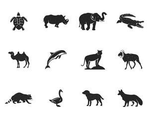 Wild animal figures and shapes collection isolated on white background. Black silhouettes turtle, rhino, dolphin, swan, tiger, camel, raccoon, fox, dog and othersl. Animals shapes bundle. .