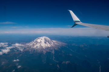 airplane wing over mountain
