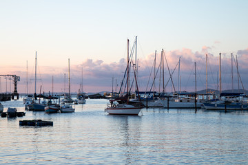 Sunset with Sailboats anchored in the pier