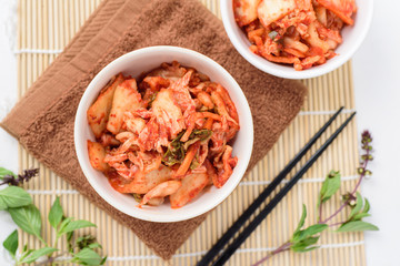 Kimchi cabbage (Korean food) in a bowl, top view