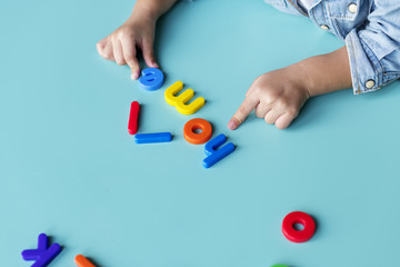 Kid with toys on a table