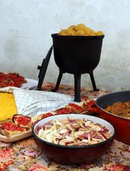 onion salad and metal pot with polenta