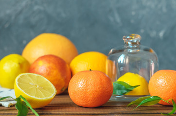 Fresh citrus fruits on wooden table.