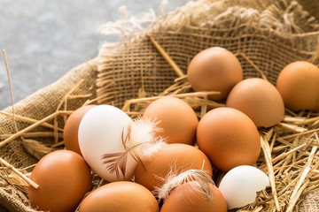 bunch of fresh brown eggs  in a wooden crate