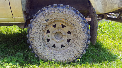 Vehicle car tire pick-up with mud on wheel