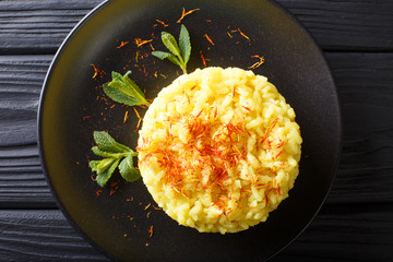 risotto from rice carnaroli with saffron and mint closeup. horizontal top view from above