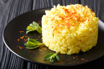 Vegetarian Italian food: risotto with saffron and mint (Risotto alla milanese) closeup. horizontal