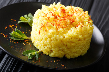 risotto from rice carnaroli with saffron and mint closeup. horizontal view
