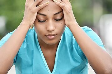 Hispanic Female Nurse And Stress