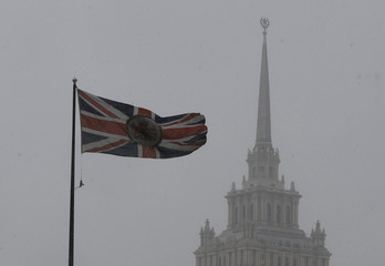 The British flag flies on the embassy building, with the Radisson Royal Hotel seen in the background, in Moscow