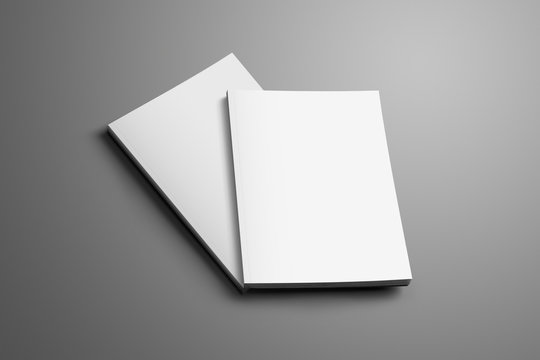 Two blank closed A4, (A5) brochures with soft realistic shadows isolated on gray background.