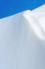 snow dunes on a blue background